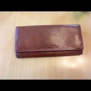 Kate Spade tan and pink wallet.